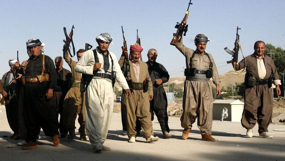 Kämpfer der kurdischen Peshmerga-Truppen: Sie sollen deutsche Waffen erhalten. Auch die Entsendung von Ausbildern wird erwägt