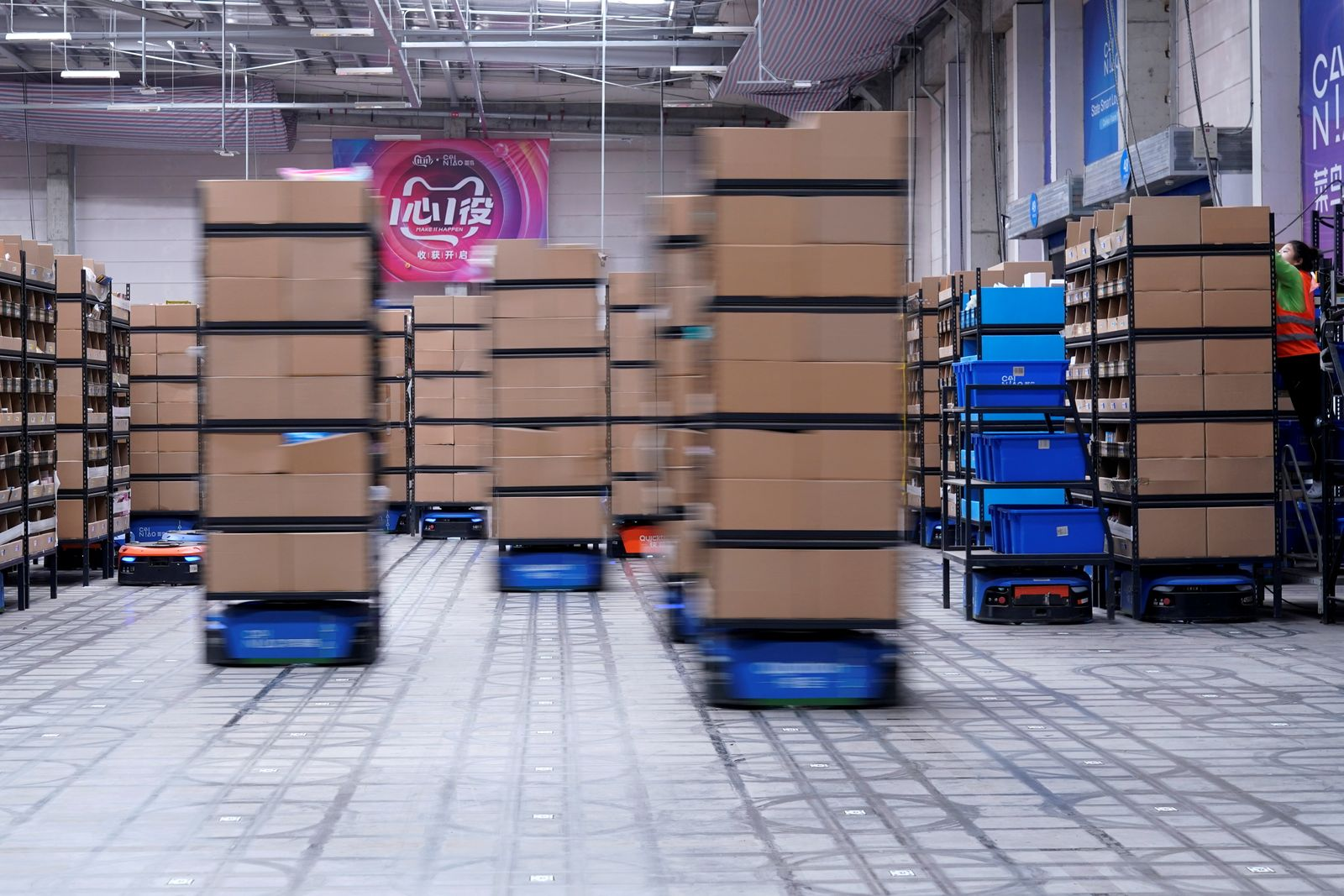 Robots work at Cainiao, Alibaba's logistics unit in Wuxi