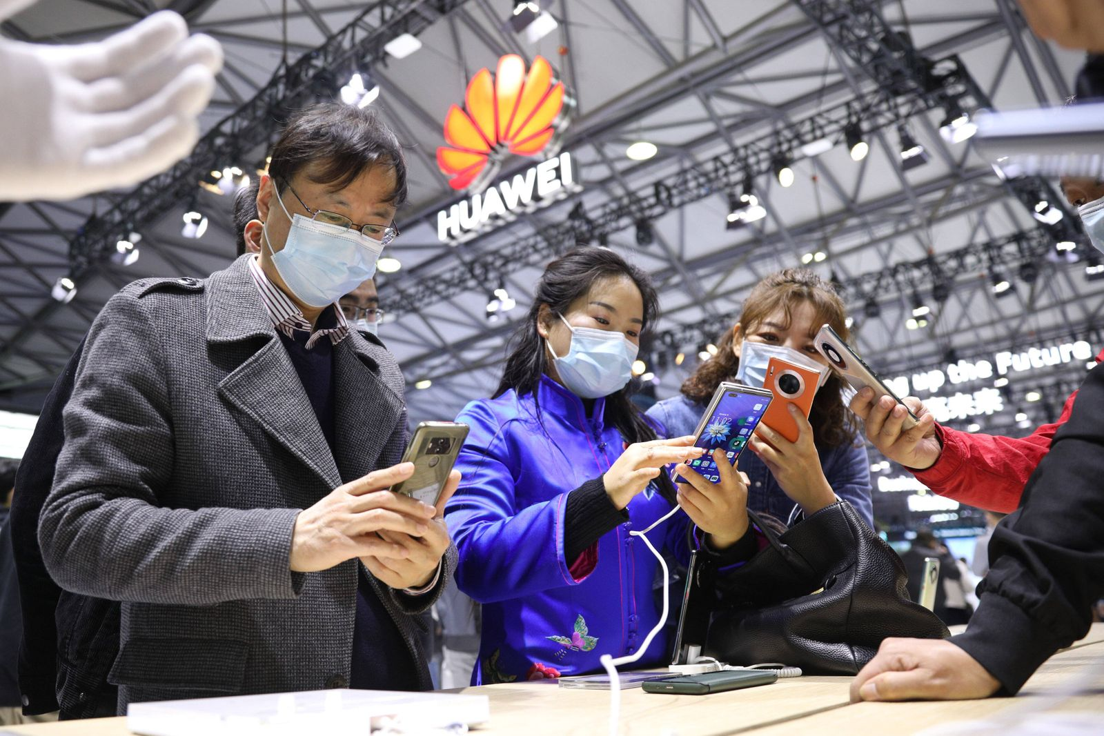 SHANGHAI, CHINA - FEBRUARY 23: Visitors try out Huawei Mate X2 foldable smartphones during the Mobile World Congress (N