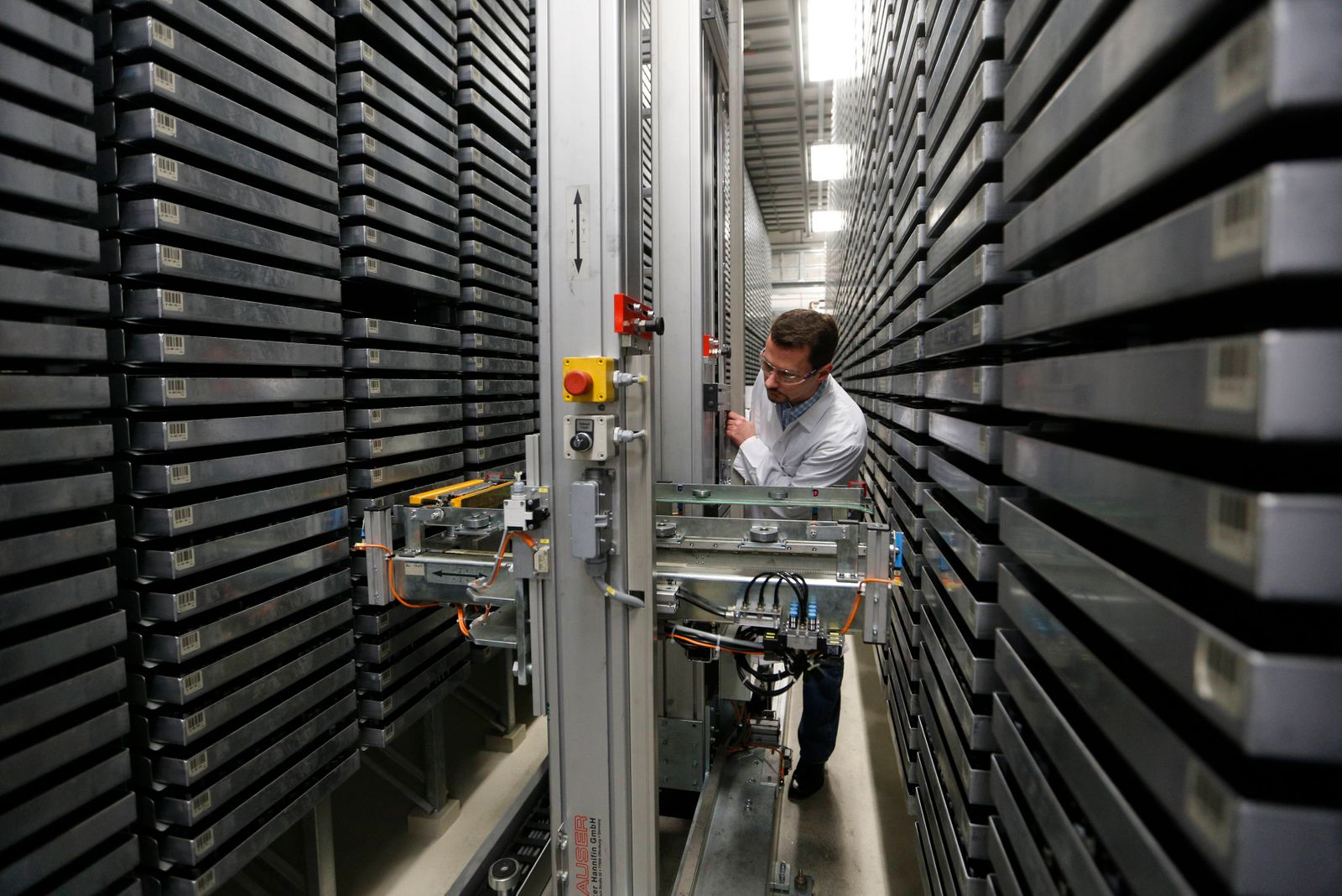 An employee monitors an automated substance library at the Pharma Research Center of Bayer HealthCare in Wuppertal
