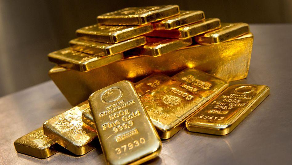Begehrte Barren: Wurde am Goldpreis jahrelang gedreht? Am Donnerstag war der Preis über die Marke von 1300 Dollar geklettert, was Händler allerdings auch mit der Aussicht auf eine anhaltend lockere Geldpolitik in den USA begründen