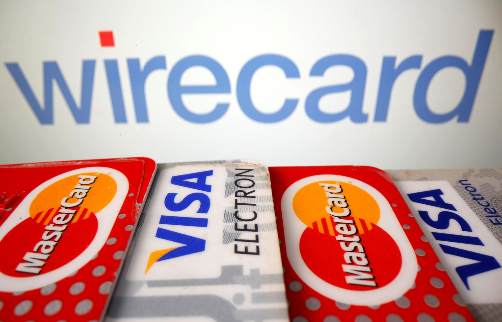 Mastercard and Visa credit cards are seen in front of displayed Wirecard logo in this illustration picture