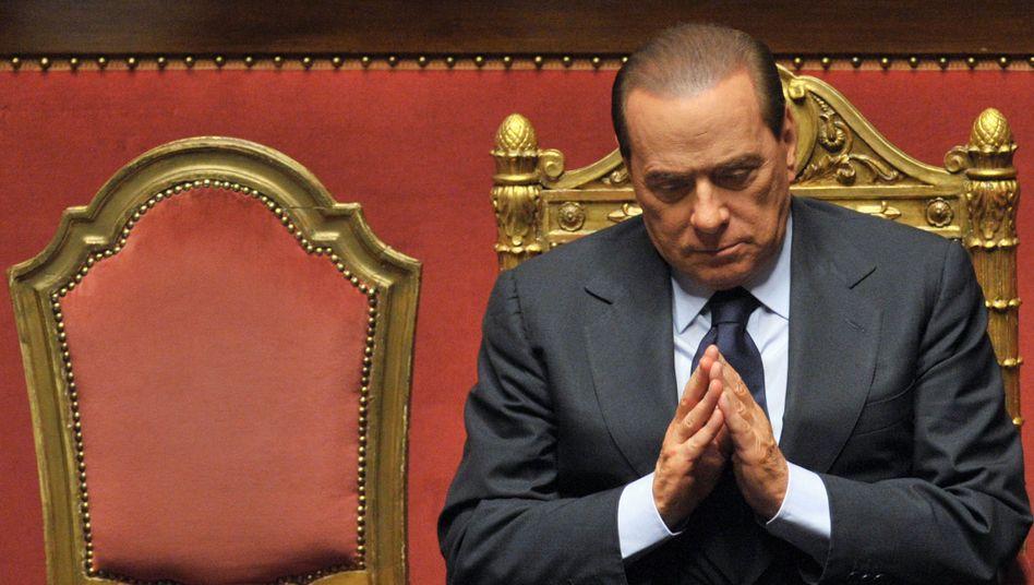 In Demutshaltung: Auch nach Berlusconis angekündigten Rücktritt trauen die Investoren Italien nicht über den Weg