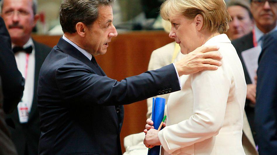 Frankreichs Präsident Nicolas Sarkozy und Kanzlerin Angela Merkel: Überraschende Offensive