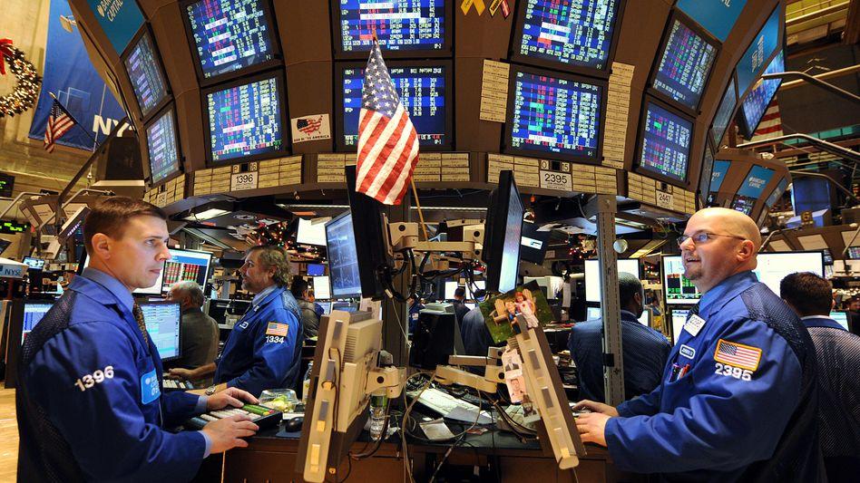 Händler an der Wall Street: Der Dow Jones stürzte nach der Fitch-Mitteilung ab