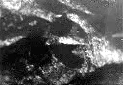 BU:This is one of the first one of the first raw images returned by the ESA Huygens probe during its successful descent.It was taken at an altitude of 8 kilometres with a resolution of 20 metres per pixel. It shows what could be the landing site, with shorelines and boundaries between raised ground and flooded plains. The European space probe has landed on the surface of Saturn's moon Titan after a seven-year journey, a space official said Friday 14 January 2005, buoying hopes that the mission could shed light on the origins of life on Earth. Mission controllers were confident the Huygens probe made a soft landing by parachute because it was transmitting steadily long after it was to have landed, said David Southwood, the European Space Agency's science director