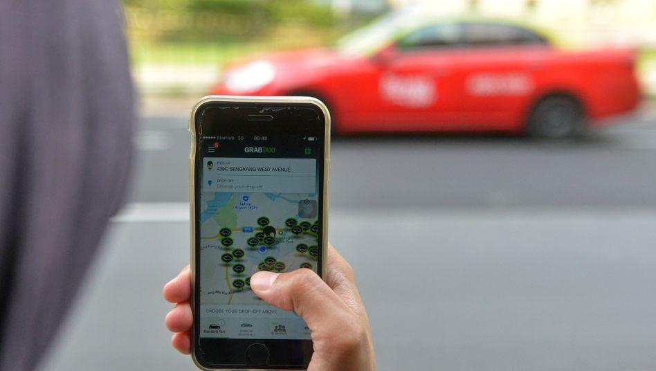 Auto-Ruf per GrabTaxi: Vier große Uber-Konkurrenten, darunter Grabtaxi, bündeln ihre Kräfte gegen Uber