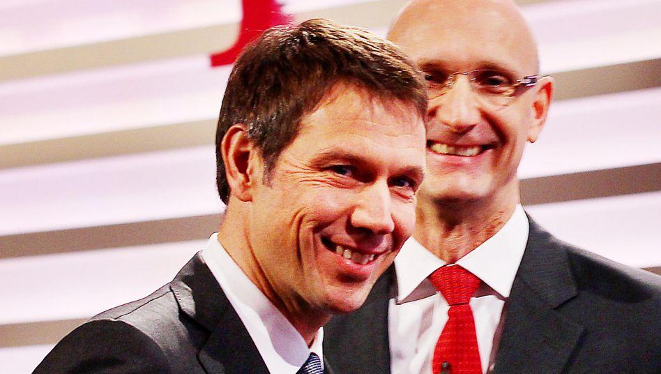 Haben gut Lachen: Telekom-Chef René Obermann und sein Finanzchef Timotheus Höttges haben für T-Mobile USA einen guten Preis erzielt