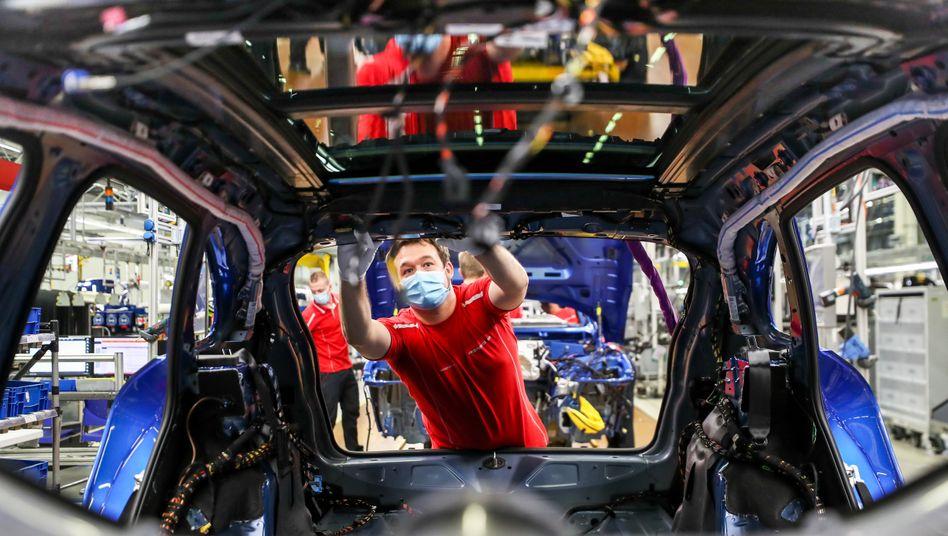 Porsche-Mitarbeiter in Leipzig: Der technologischen Disruption der Industrie muss ein Umbruch im Denken und Handeln der Unternehmen folgen