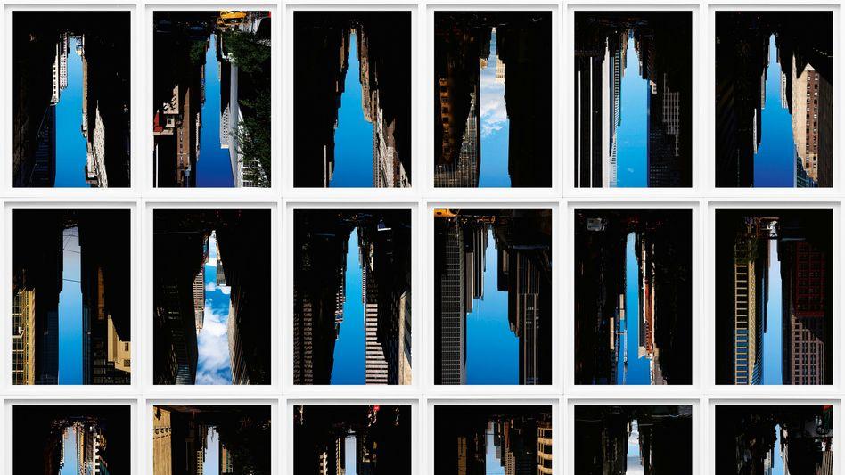 """Die Bilder des US-Künstlers Peter Wegner zeigen invertierte Aufnahmen von Straßenschluchten aus der Serie """"Buildings Made of Sky"""". Die Schlucht erscheint dadurch selbst als Hochhaus."""
