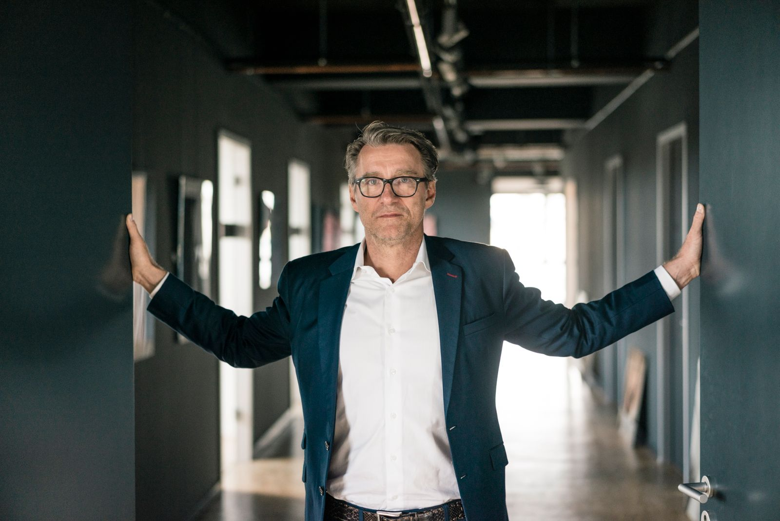 Portrait of mature businessman standing on office floor