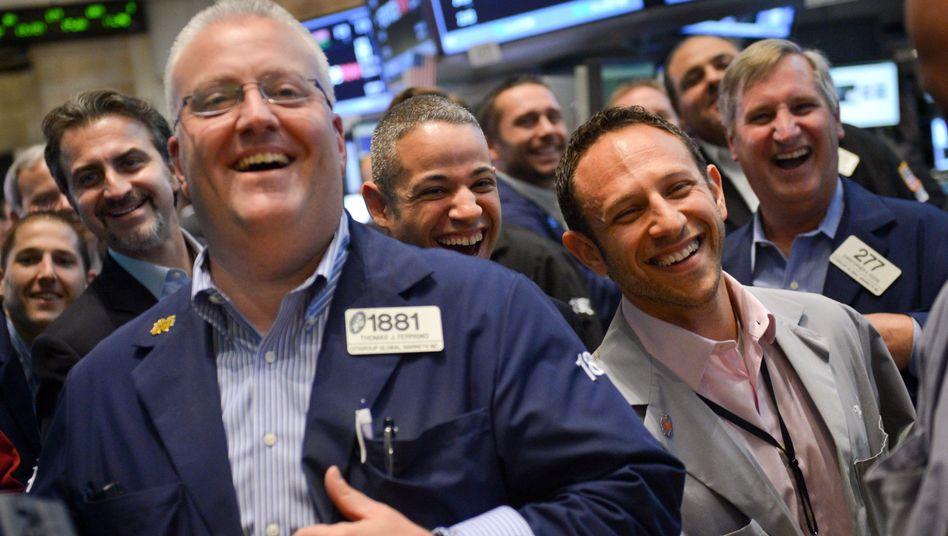 Börsenhändler an der Wall Street: US-Investoren verdienen an der Dax-Hausse, während deutsche Privatanleger den Aufschwung häufig nur in den Medien verfolgen