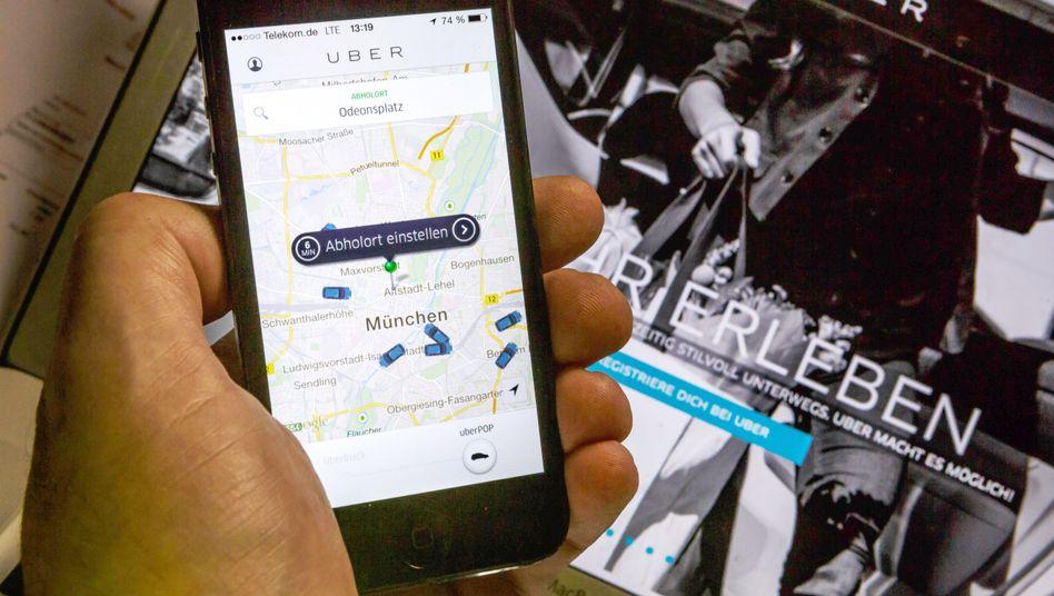 App der Online Plattform Uber: weniger Regeln, mehr Konkurrenz