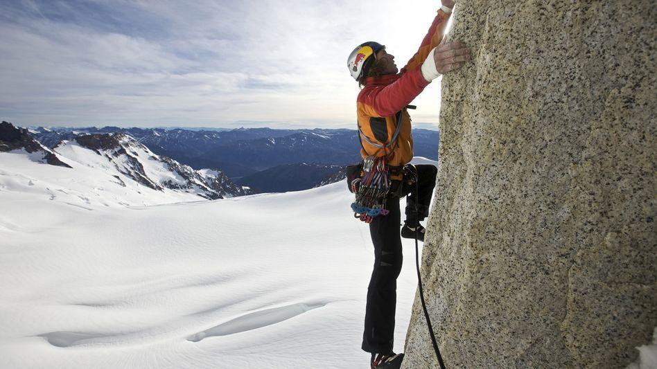 Kletterer am Berg: Auch an der Börse erwarten Experten, dass es noch aufwärts geht. Allerdings nicht mehr allzu weit