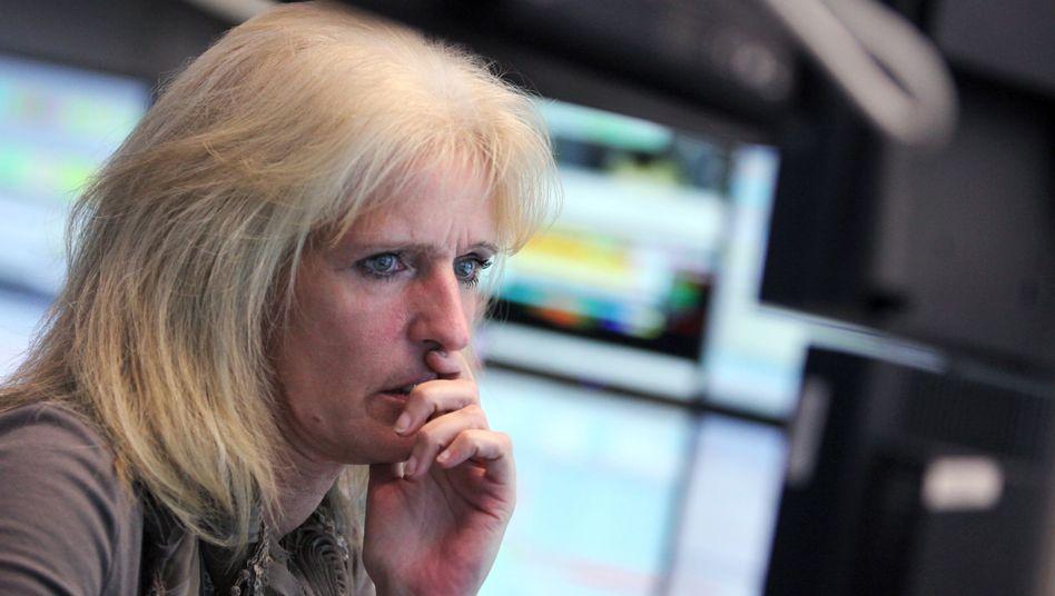Skeptischer Blick: Händlerin an der Frankfurter Börse