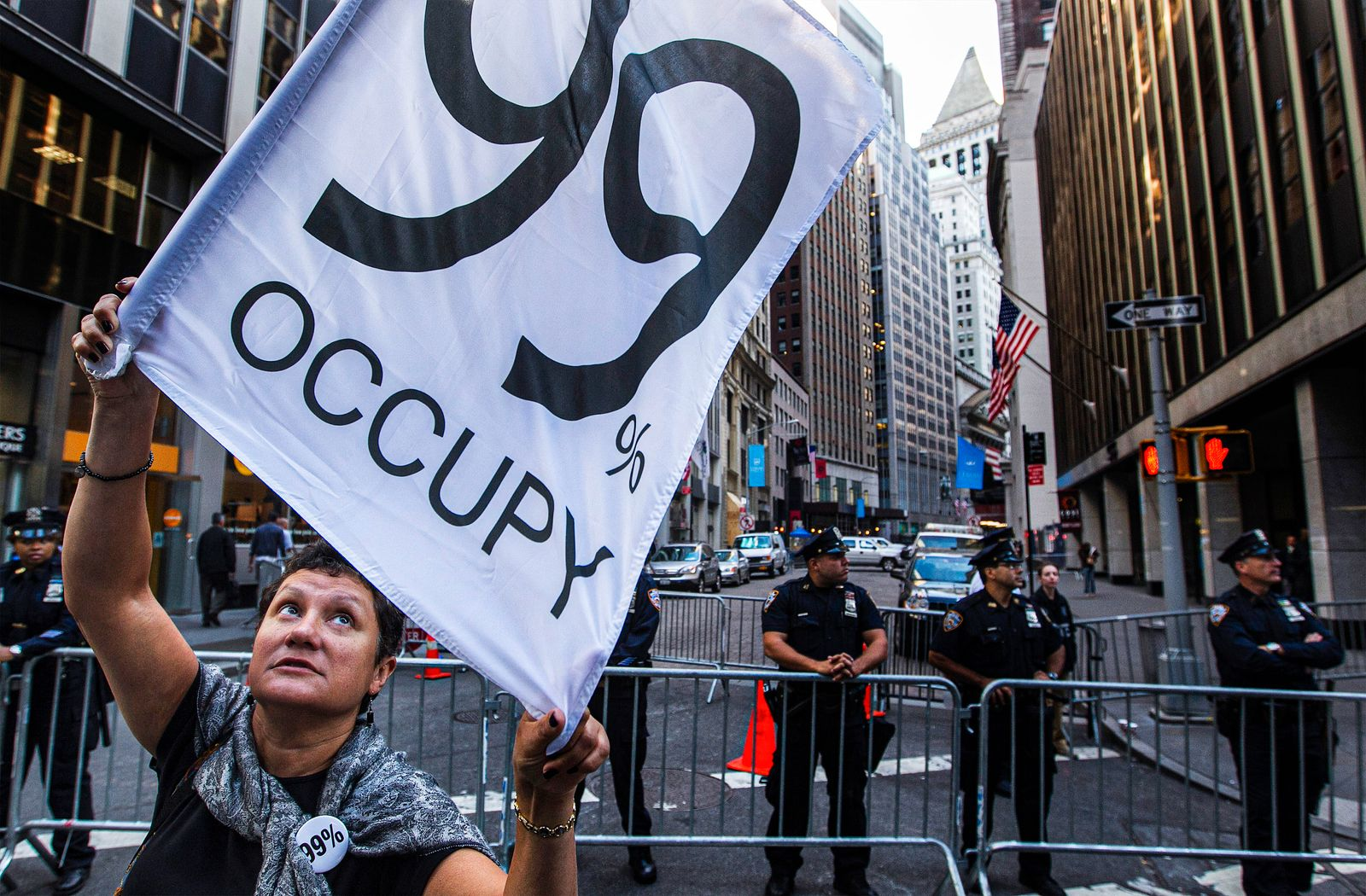 A Occupy Wall Street activist marches with demonstrators through the financial district during the one-year anniversary of the movement in New York