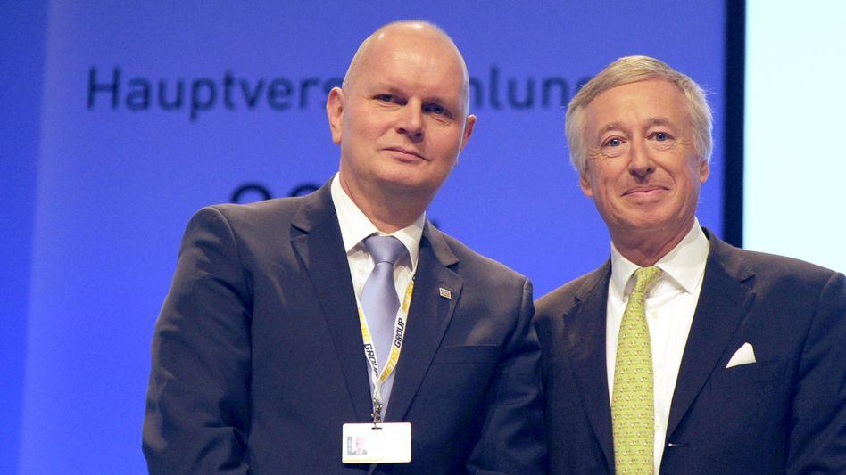 Blassgrün ist die Hoffnung: Metro-Aufsichtsratschef Franz Haniel (rechts) mit seinem Vorstandschef Olaf Koch.