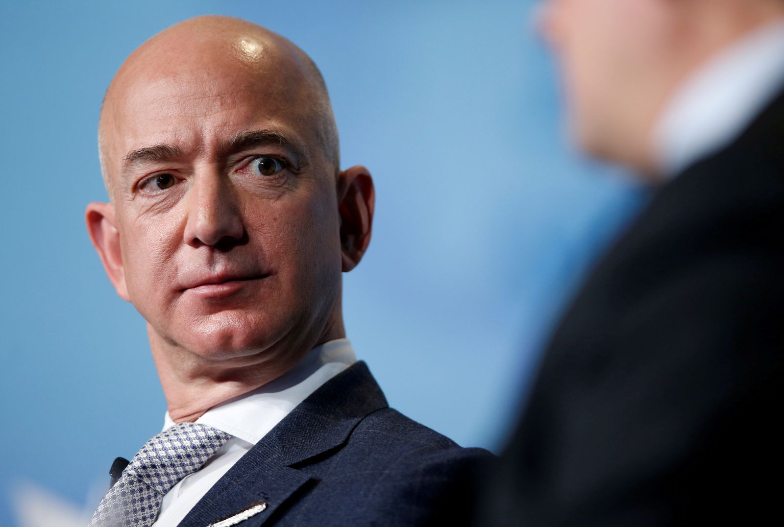 FILE PHOTO: Jeff Bezos, founder of Blue Origin and CEO of Amazon, speaks about the future plans of Blue Origin in Washington