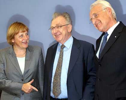 Merkel, Späth und Stoiber (v.l.) bei der Vorstellung des neuen Hoffnungsträgers.