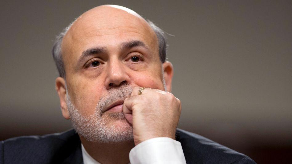 Fed-Chef Ben Bernanke: Derzeit pumpt die Fed 85 Milliarden US-Dollar pro Monat in den Markt. Die 12 Mitglieder des Offenmarktausschusses sind sich nicht einig darüber, wann der Einstieg in den Ausstieg beginnen soll