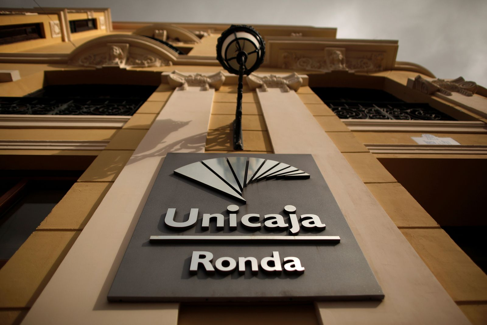 FILE PHOTO: The logo of Unicaja bank is seen on the facade of a Unicaja bank branch in downtown Ronda
