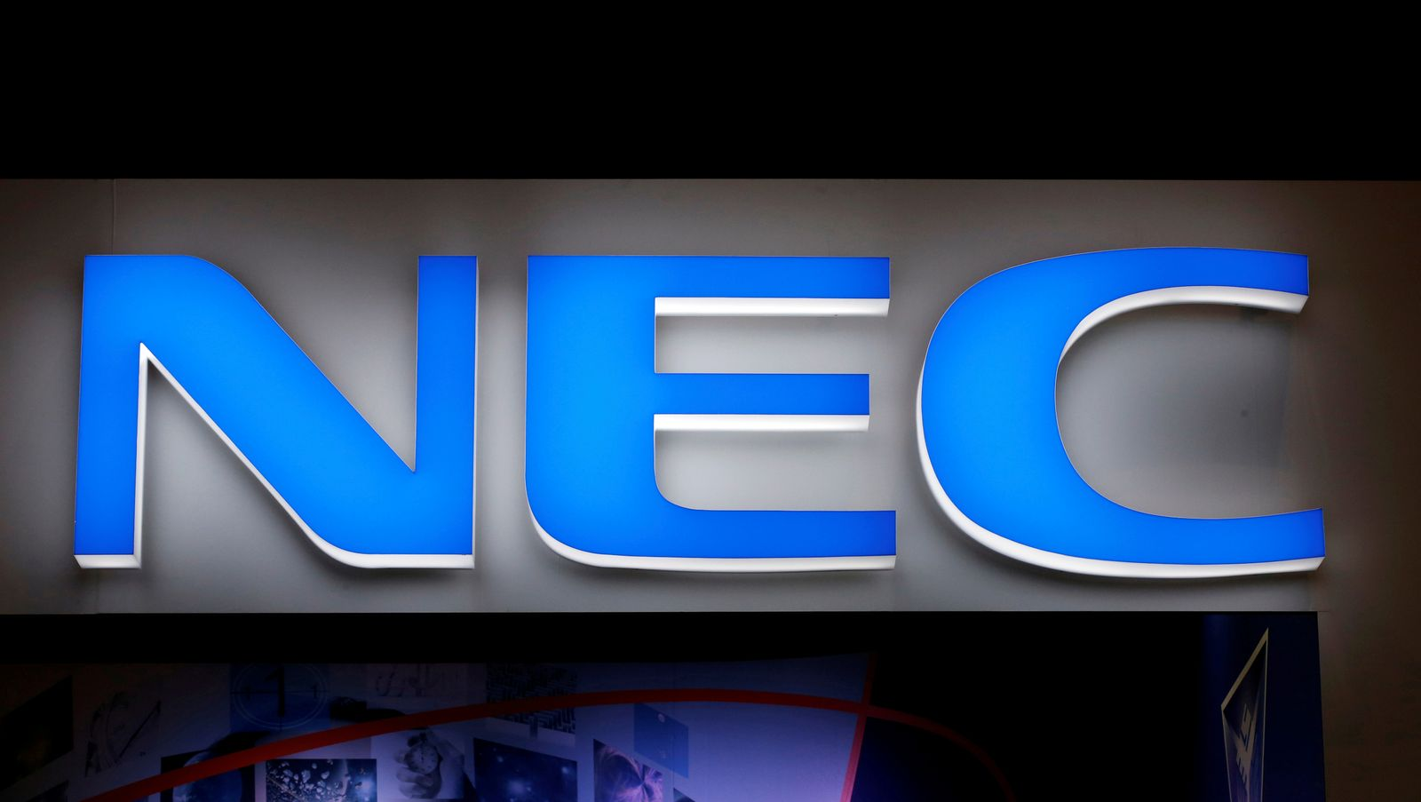 FILE PHOTO: Logo of NEC Corp is pictured at CEATEC JAPAN 2016 in Chiba