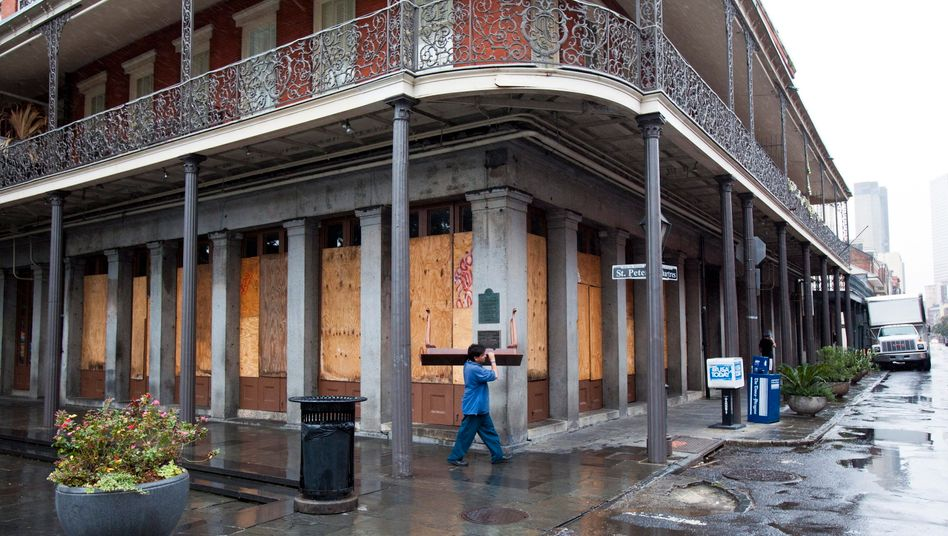 A resident moves some of his personal belongings near the boarded up Pontalba Apartments in Jackson Square in the historic French Quarter in a last minute preparation for Tropical Storm Isaac, in New Orleans