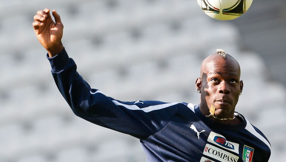 Eyes on the ball: Italy's Mario Balotelli during a training session