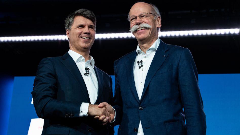 Schulterschluss: BMW-Chef Harald Krüger und Daimler-Chef Dieter Zetsche wollen im Team zum Google-Konkurrenten Waymo aufschließen