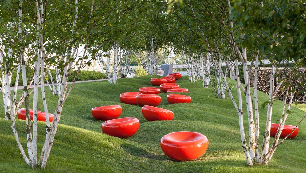 Wasser, Feuer, Erde: Ein schöner Garten spielt mit den Elementen