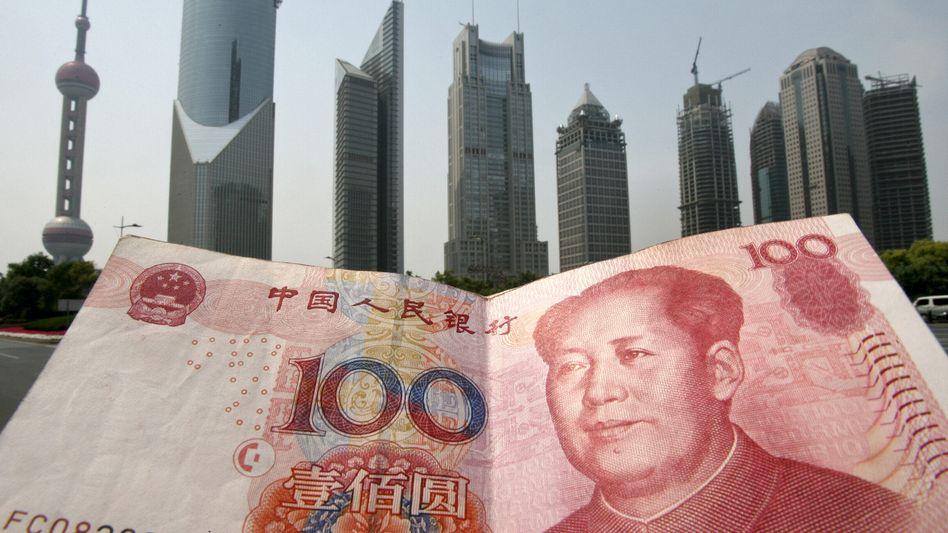 Wettlauf der Währungen: Die Leitwährung US-Dollar dürfte noch mehr Konkurrenz bekommen, wenn China seine Finanzmärkte für ausländische Teilnehmer öffnet
