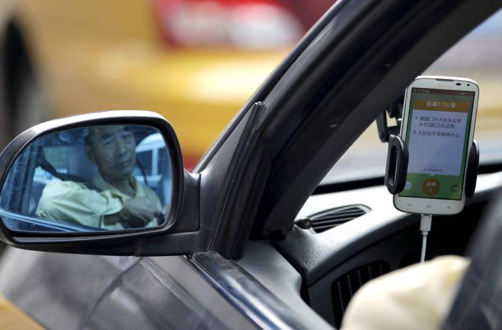 Warten auf Kunden: Mitfahrdienst Didi Chuxing ist Marktführer in China - und liefert sich mit Uber einen ruinösen Preiskampf