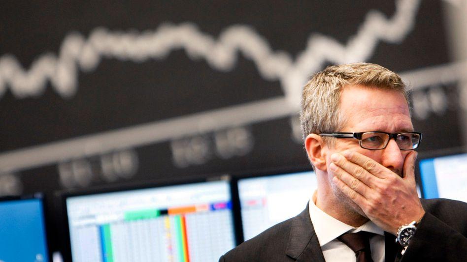 Börsianer in Frankfurt: Der US-Haushaltsstreit belastet die Märkte weltweit