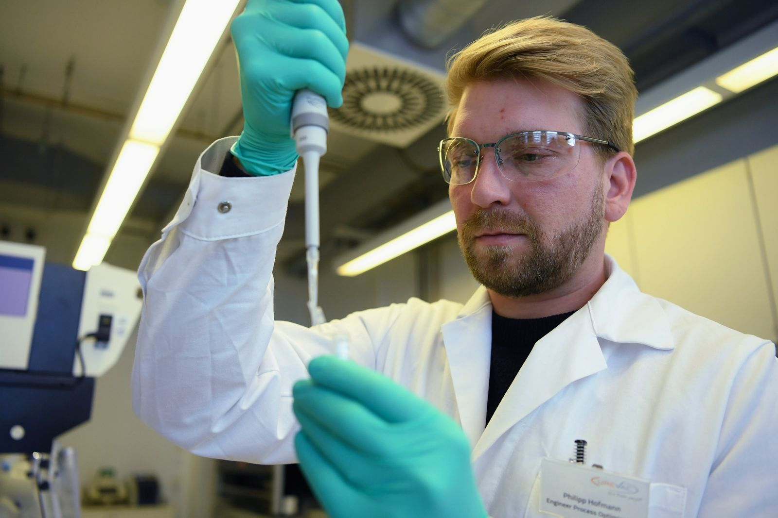 Employee Philipp Hoffmann, of German biopharmaceutical company CureVac, demonstrates research workflow on a vaccine for the coronavirus (COVID-19) disease at a laboratory in Tuebingen