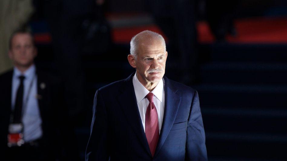 Griechenlands Premier Papandreou: Um gemeinsam mit den Konservativen eine Übergangsregierung aufzustellen, verzichtet Papandreou auf sein Amt