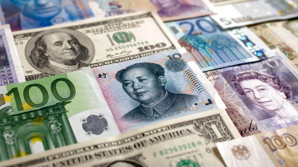 Yen, Euro, Dollar: Die Notenbanken großer Schwellenländer haben riesige Gelddepots aufgebaut - ihre Zusammensetzung bleibt jedoch im Dunklen. Die Notenbanken werden dadurch zu verdeckt agierenden Spielern