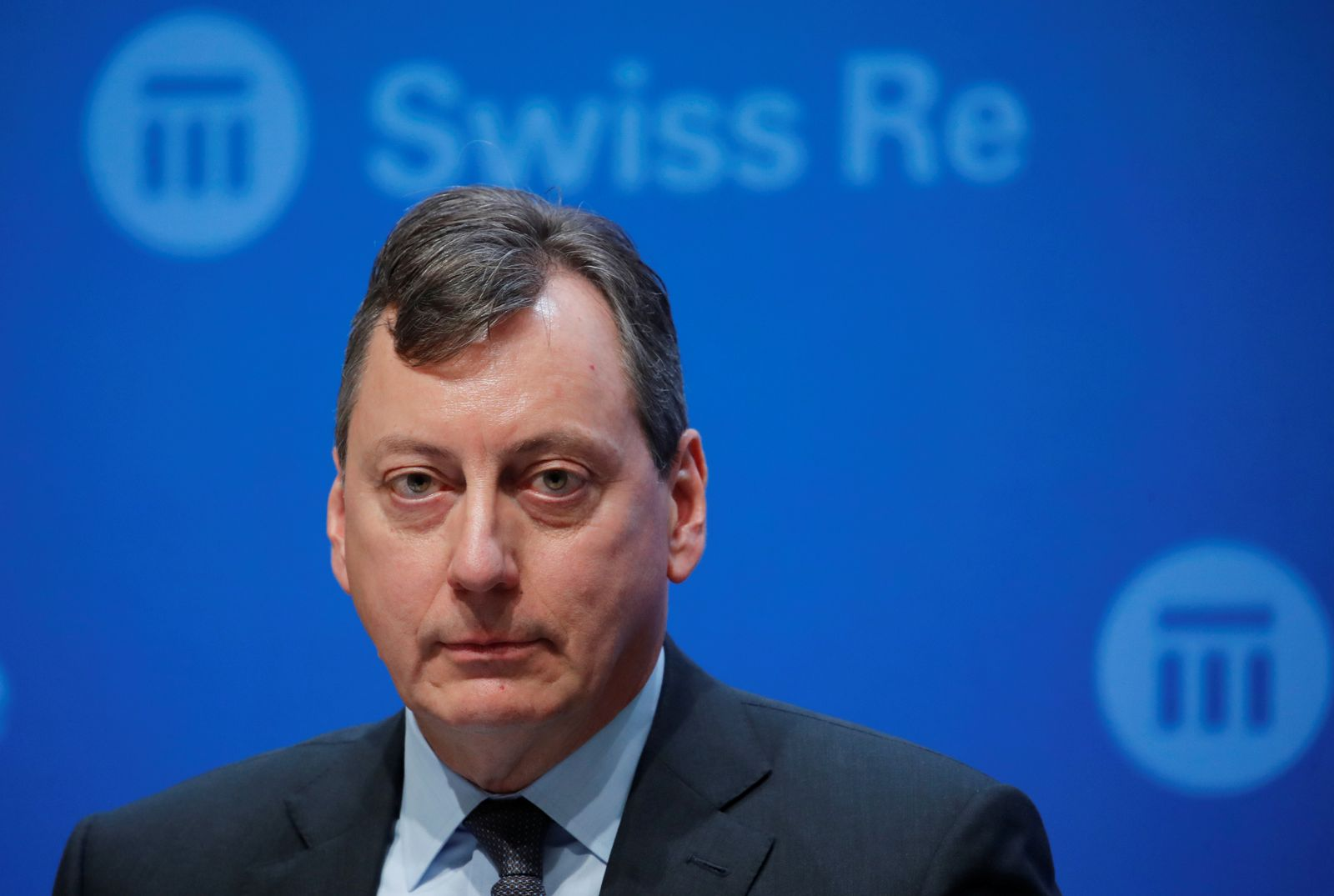 CFO Dacey of reinsurer Swiss Re addresses a news conference in Zurich