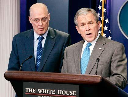 Betretene Gesichter statt Vertrauen: Finanzminister Paulson (li.), Präsident Bush