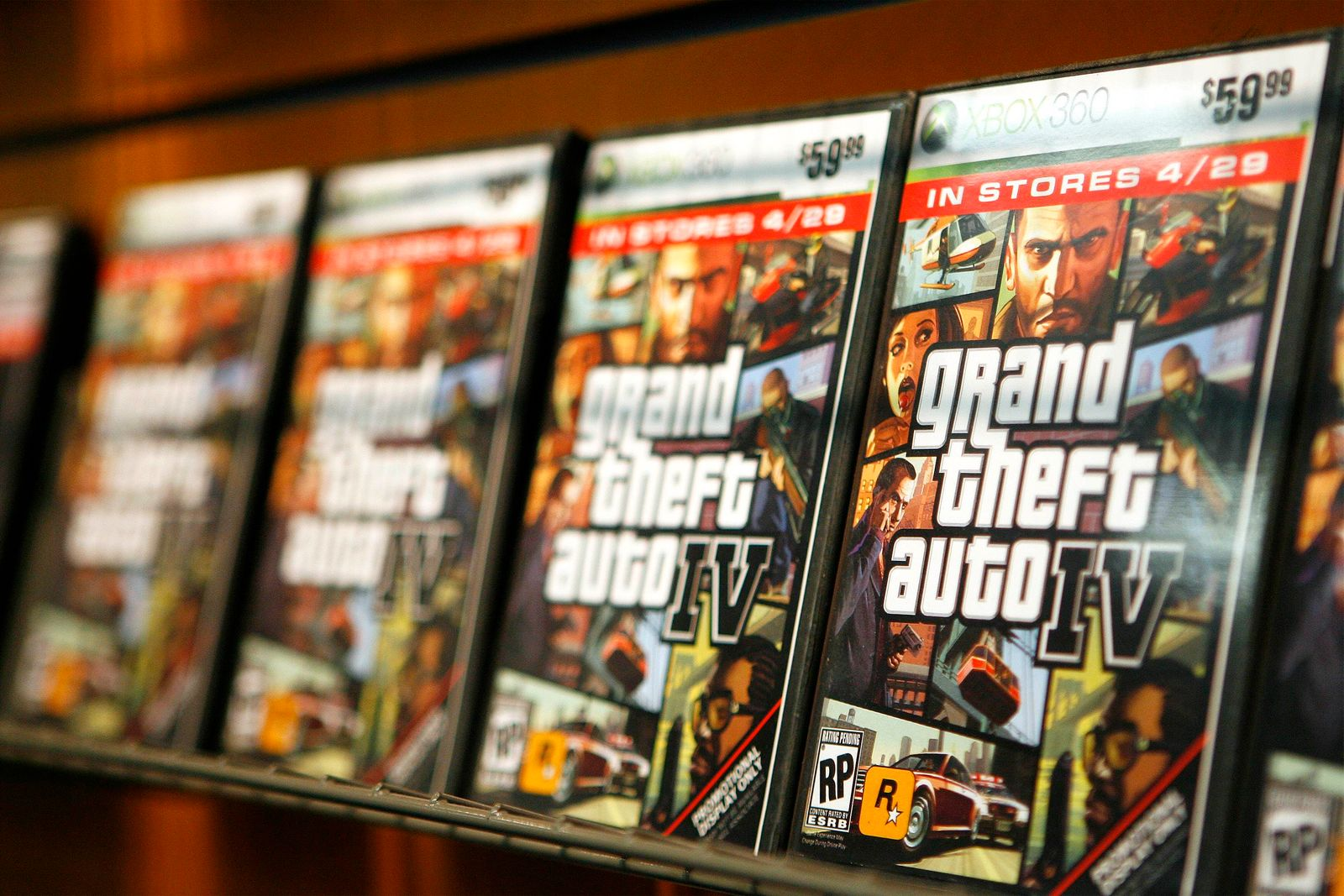 """""""Grand Theft Auto IV"""" video game boxes are displayed on a rack inside a GameStop store in New York prior to midnight release of the video game"""