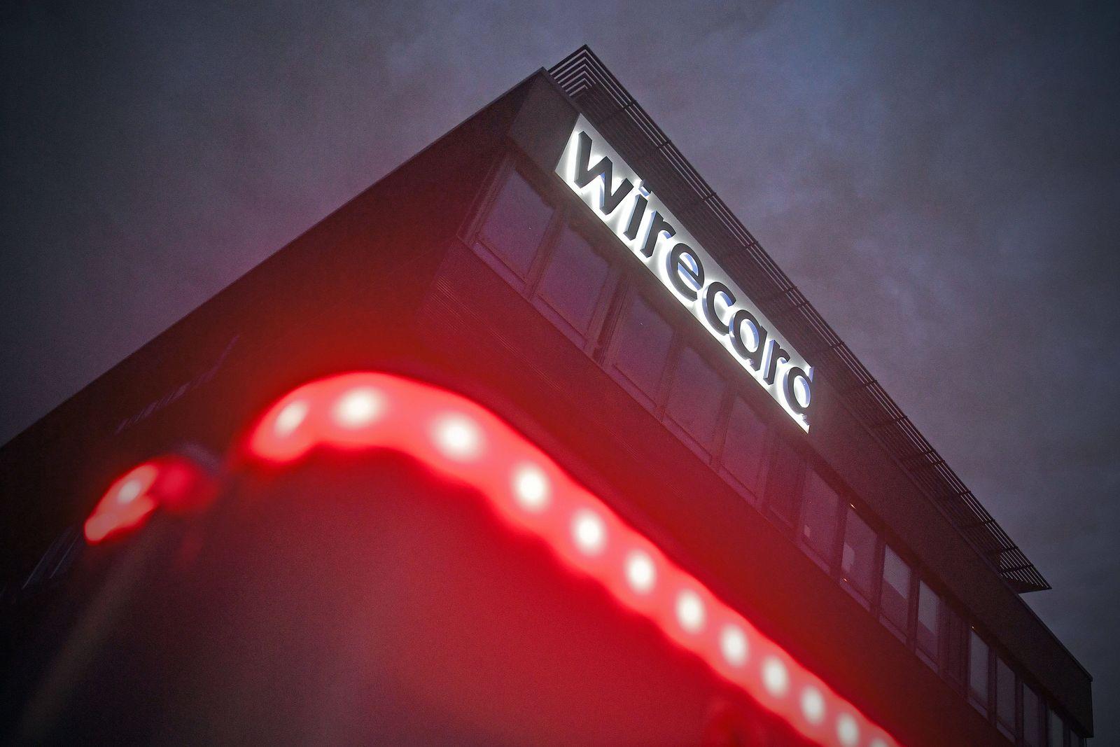 wirecard Bilanzskandal: Ermittler durchsuchen Wirecard-Bueros. wirecard Logo, Firmenemblem,Schriftzug ,Gebaeude, Fassade