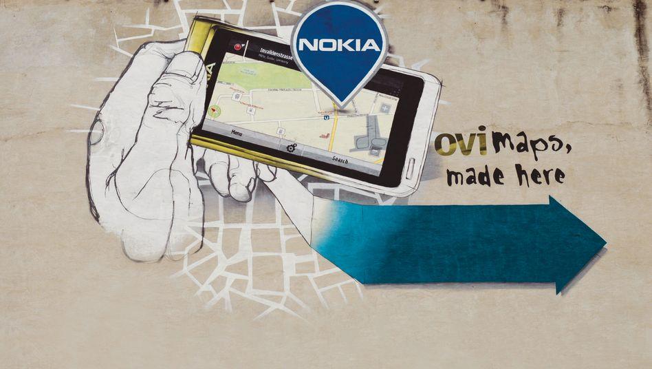 Graffito am Nokia-Standort Berlin: Der weltgrößte Handyhersteller sucht bei Smartphones, Apps und Wachstum Anschluss an die Konkurrenz