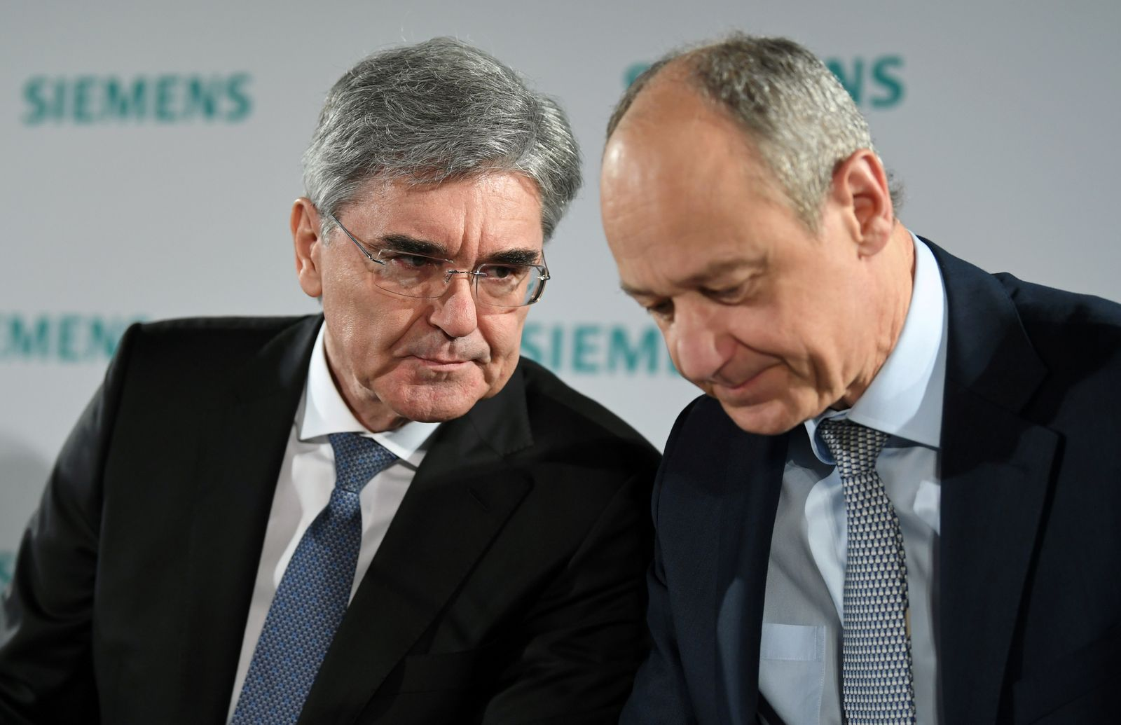 German engineering group Siemens CEO Joe Kaeser and deputy CEO Roland Busch attend a news conference prior to the annual general meeting in Munich