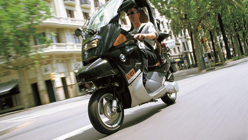 Motorroller BMW C1: Einst verschmäht, heute beliebt. Das Konzept sollte die Effizienz eines Rollers mit der Sicherheit eines Kleinwagens kombinieren