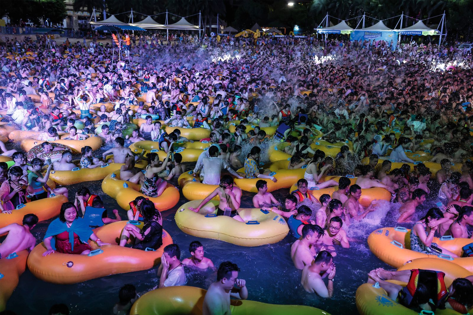 People enjoy a music party at the Wuhan Maya Beach Park, in Wuhan, following the coronavirus disease (COVID-19) outbreak
