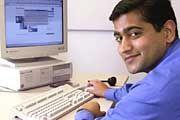 Inder an seinem Arbeitsplatz in Deutschland