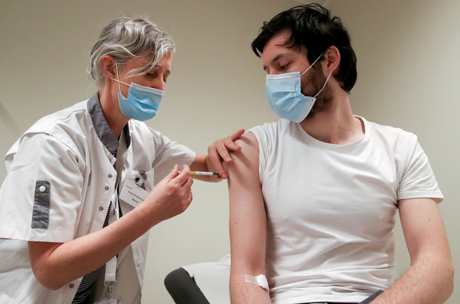 FILE PHOTO: A volunteer receives a dose of CureVac vaccine or a placebo, in Brussels