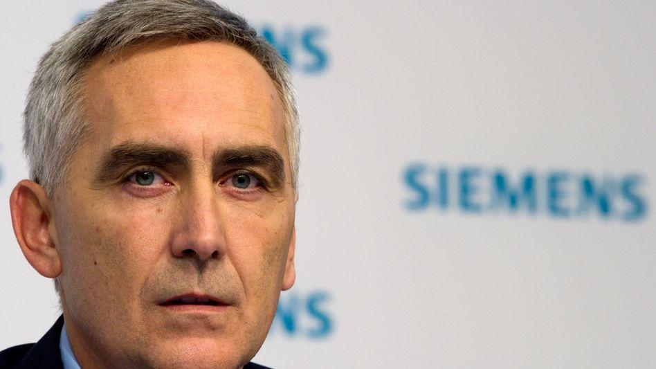 Siemens-Chef Loescher: Raus aus Briefsortierung, rein in Bahn-Leittechnik