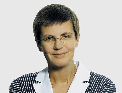 Elke König (50): Auch die Finanzchefin der Hannover Rück ist Mutter von zwei Kindern. Ihre Karriere begann sie als Prüfungsassistentin bei KPMG.