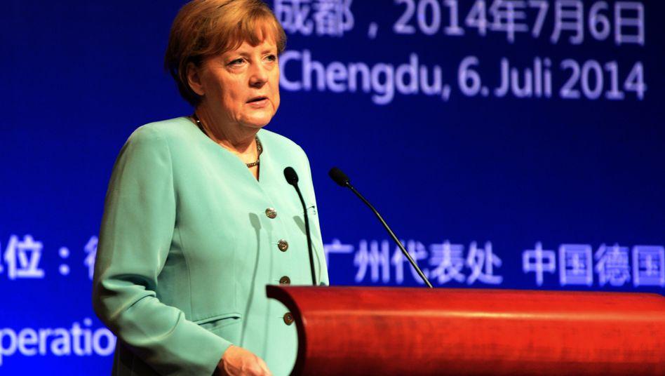 Merkel auf China-Reise: Überrascht und fassungslos