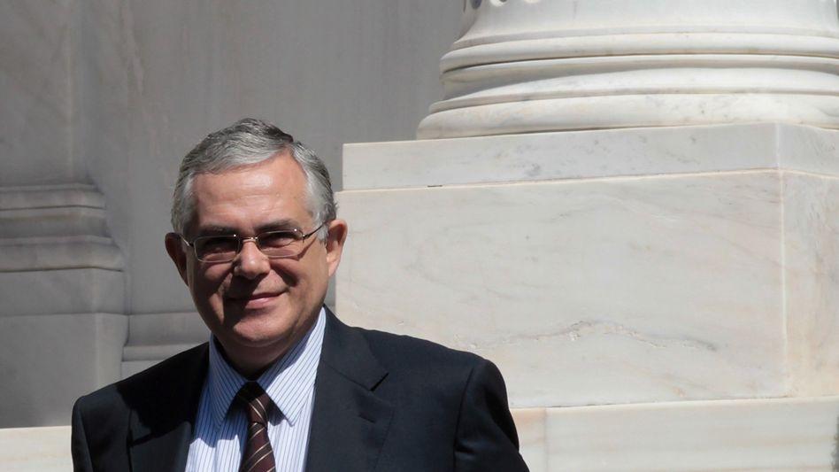 Lucas Papademos: Der Wirtschaftsprofessor soll mit seiner fachlichen Qualifikation das Vertrauen der Märkte zurückgewinnen